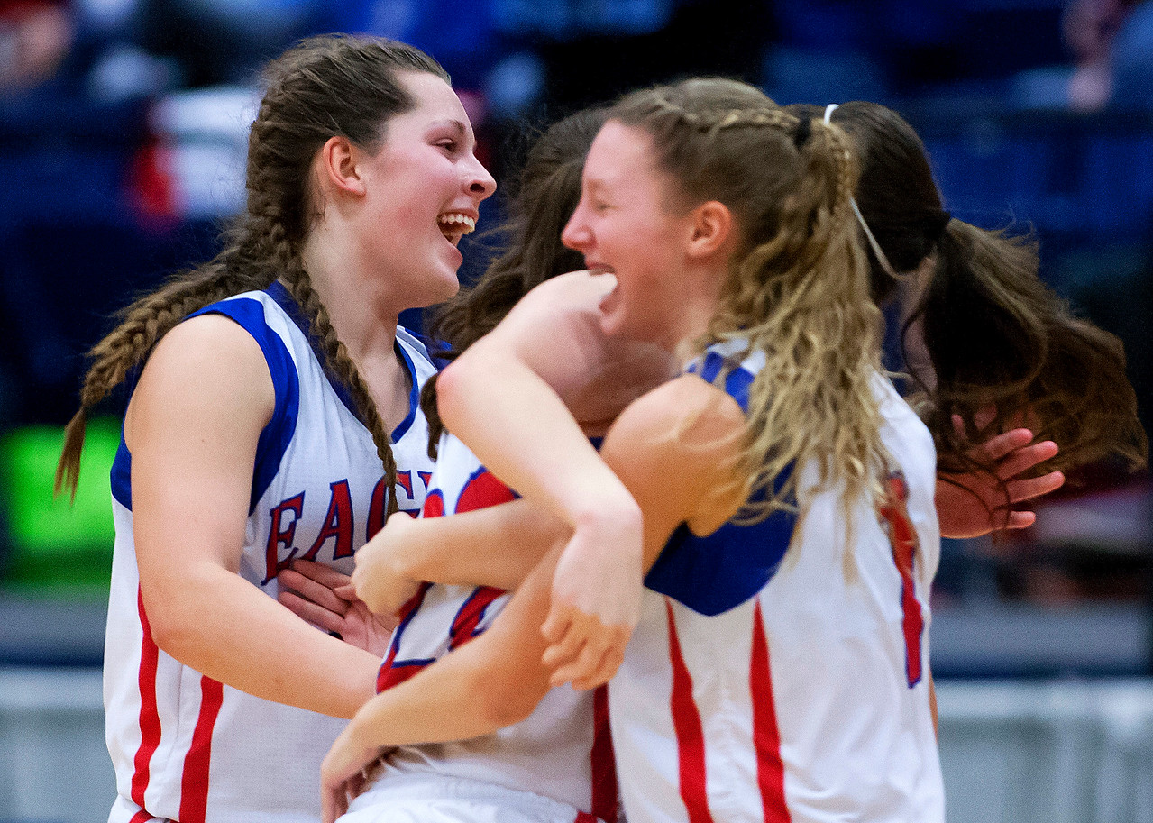 AUGUSTA, Maine -- 02/24/2017 -- Messalonskee celebrates after defeating Nokomis during their Class A girls basketball championship game at the Augusta Civic Center in Augusta Friday. Ashley L. Conti | BDN