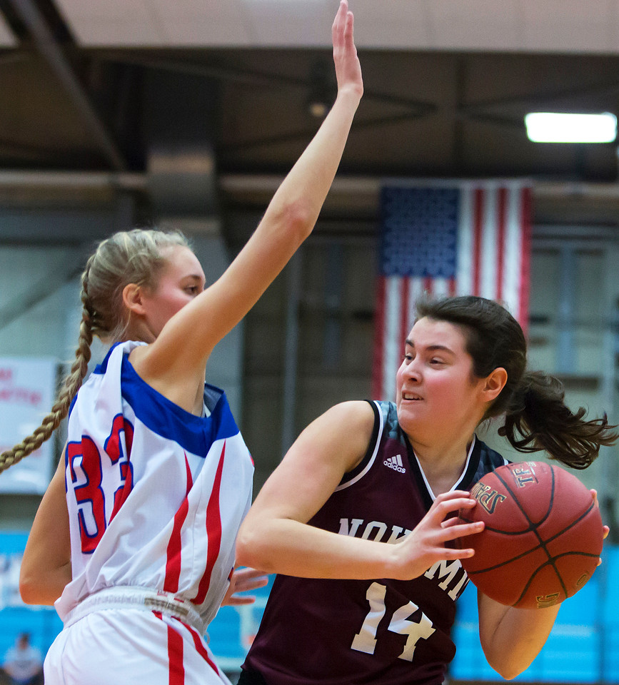 AUGUSTA, Maine -- 02/24/2017 -- Nokomis' Chelsea J. Crockett (right) tries for two past Messalonskee's Allyssa Turner during their Class A girls basketball championship game at the Augusta Civic Center in Augusta Friday. Ashley L. Conti   BDN