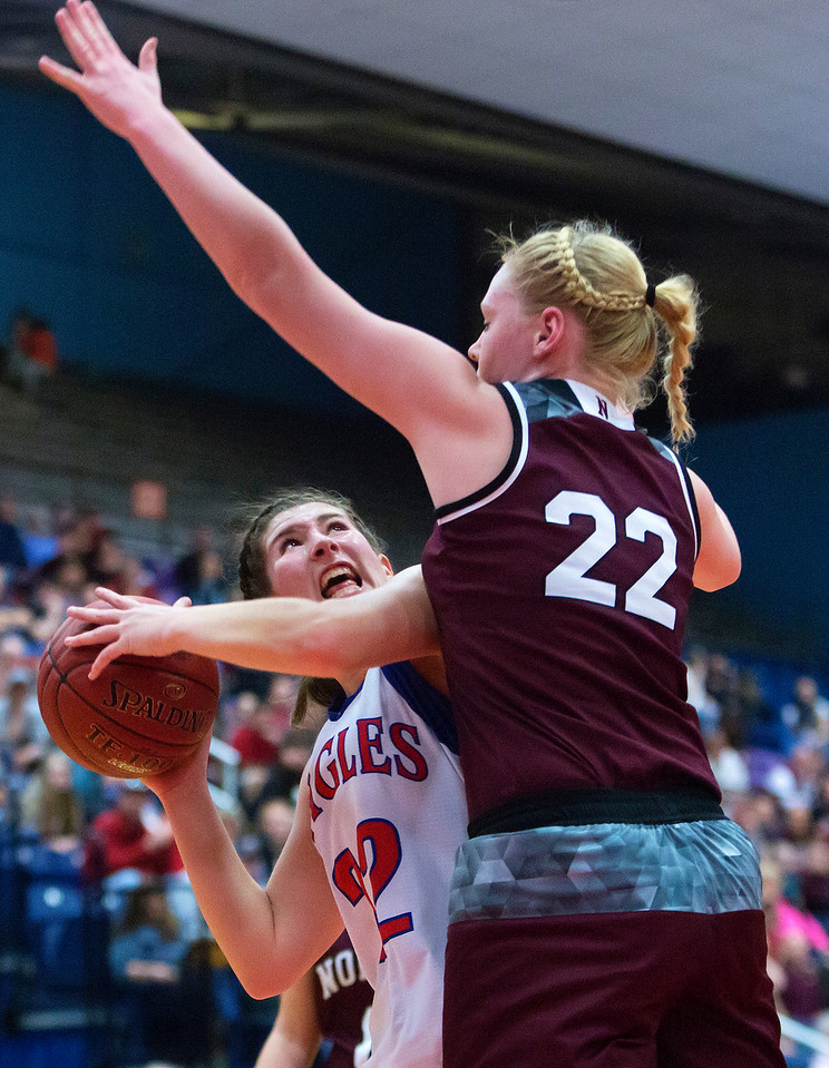 AUGUSTA, Maine -- 02/24/2017 -- Messalonskee's McKenna Brodeur (left) is fouled by Nokomis' Gabrielle E. Lord during their Class A girls basketball championship game at the Augusta Civic Center in Augusta Friday. Ashley L. Conti | BDN