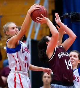 AUGUSTA, Maine -- 02/24/2017 -- Messalonskee's Allyssa Turner (left) blocks a shot from Nokomis' Chelsea J. Crockett during their Class A girls basketball championship game at the Augusta Civic Center in Augusta Friday. Ashley L. Conti | BDN