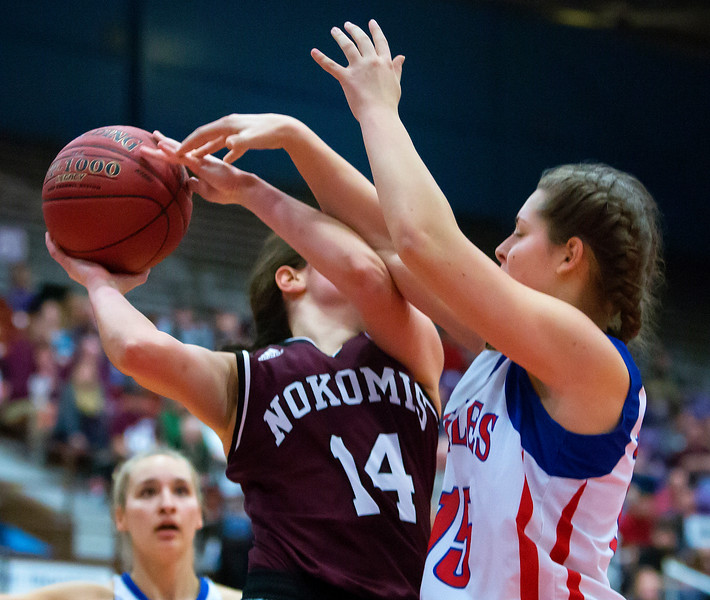 AUGUSTA, Maine -- 02/24/2017 -- Messalonskee's Makayla Wilson (right) blocks a shot from Nokomis' Chelsea J. Crockett during their Class A girls basketball championship game at the Augusta Civic Center in Augusta Friday. Ashley L. Conti | BDN
