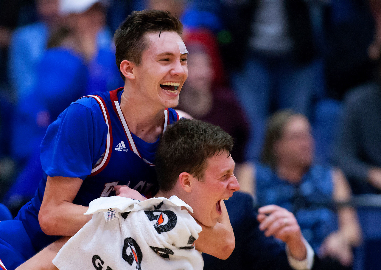 AUGUSTA, Maine -- 02/24/2017 -- Messalonskee's James Kouletsis (left) celebrates with Messalonskee's Nathan Violette after defeating Oceanside during their Class A boys basketball championship game at the Augusta Civic Center in Augusta Friday. Ashley L. Conti | BDN