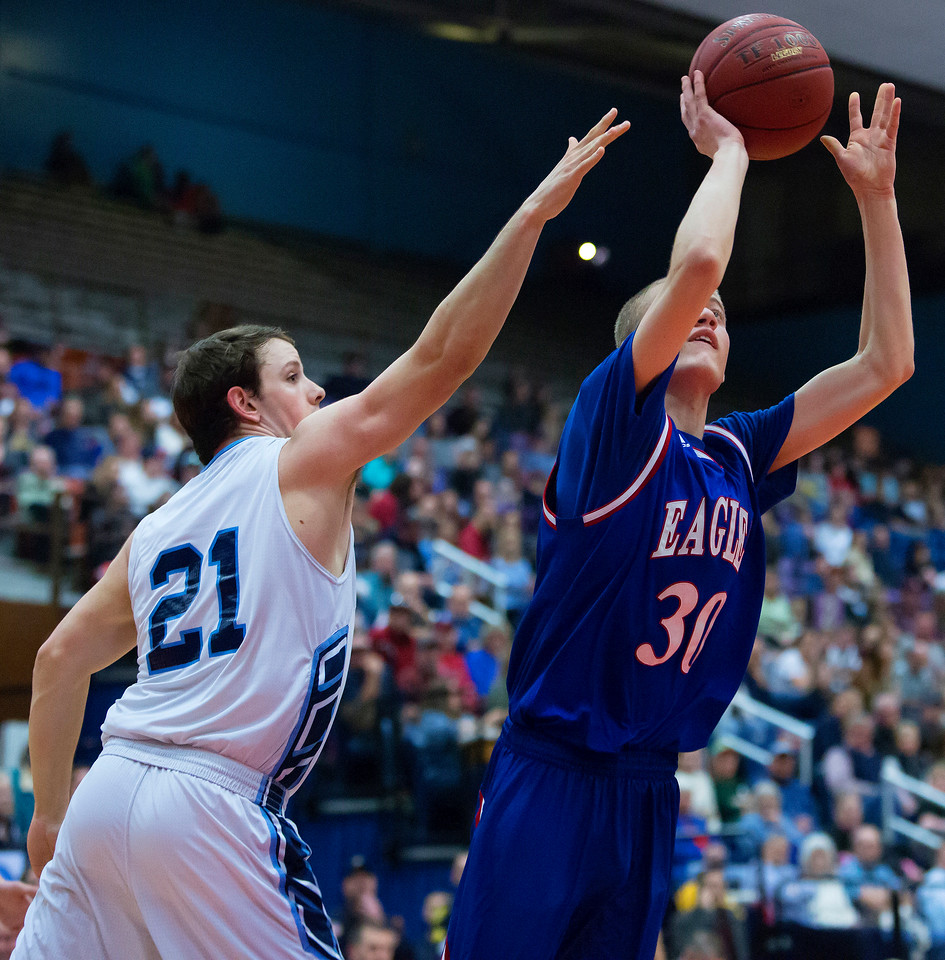 AUGUSTA, Maine -- 02/24/2017 -- Messalonskee's Cole Wood (right) drives up for two past Oceanside's Josef Berger during their Class A boys basketball championship game at the Augusta Civic Center in Augusta Friday. Ashley L. Conti | BDN