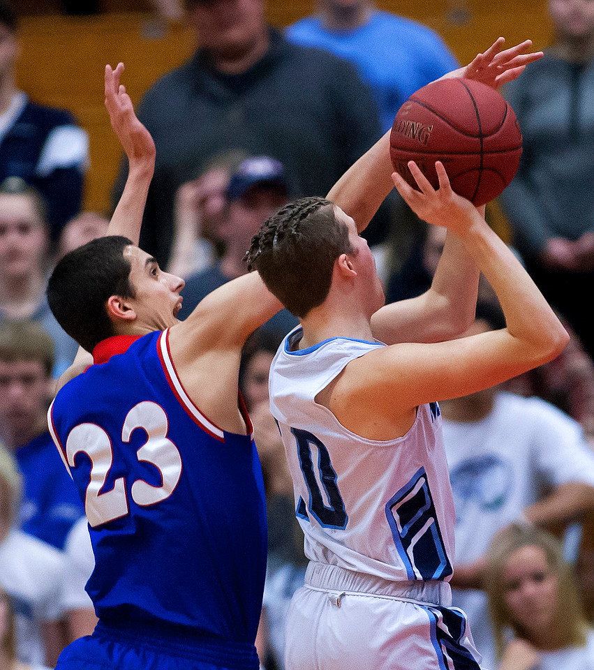 AUGUSTA, Maine -- 02/24/2017 -- Messalonskee's Griffin Tuttle (left) blocks a shot from Oceanside's Jack Lombardo during their Class A boys basketball championship game at the Augusta Civic Center in Augusta Friday. Ashley L. Conti | BDN