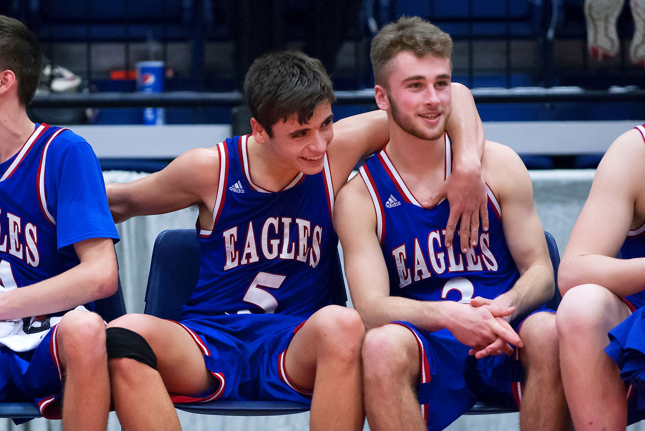 AUGUSTA, Maine -- 02/24/2017 -- Messalonskee's Chase Warren (left) celebrates with Messalonskee's Dawson Charles after realizing they will take the win against Oceanside during their Class A boys basketball championship game at the Augusta Civic Center in Augusta Friday. Ashley L. Conti | BDN