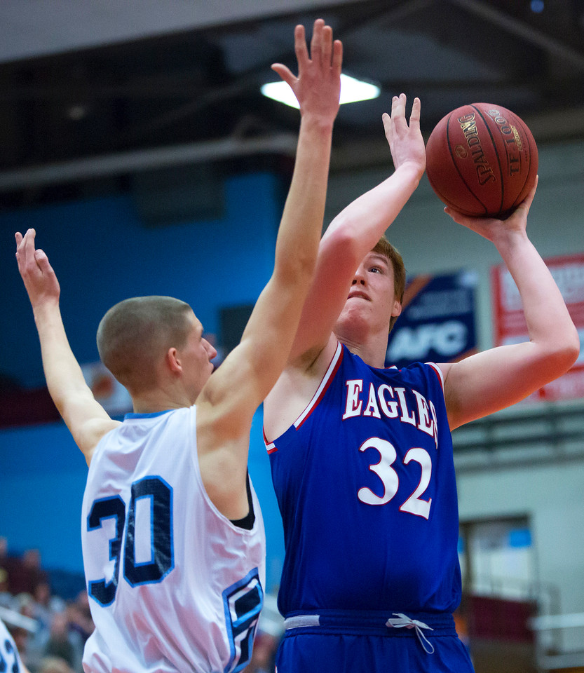 AUGUSTA, Maine -- 02/24/2017 -- Messalonskee's Trevor McCray (right) puts up a shot past Oceanside's Amos Anderson during their Class A boys basketball championship game at the Augusta Civic Center in Augusta Friday. Ashley L. Conti | BDN