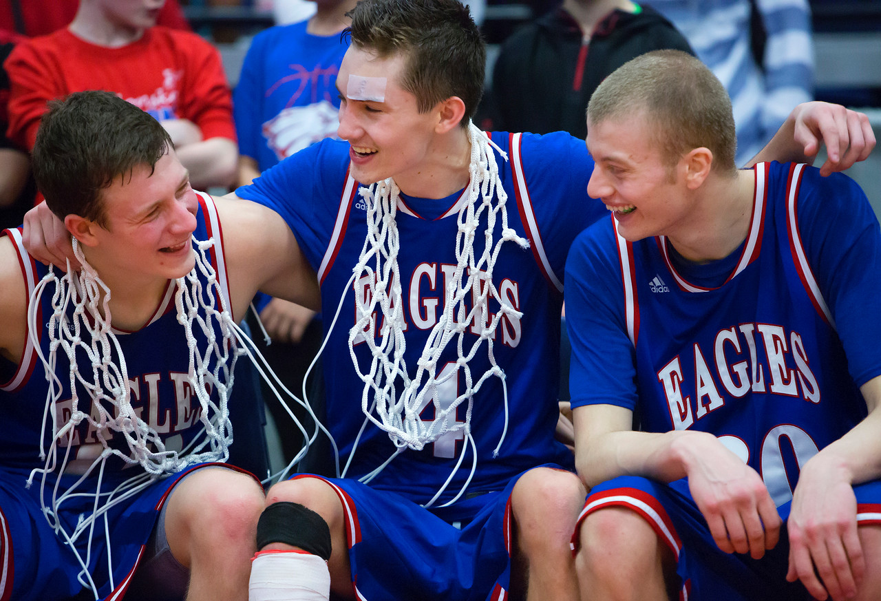 AUGUSTA, Maine -- 02/24/2017 -- Messalonskee's Nathan Violette (from left), James Kouletsis and Cole Wood celebrate after defeating Oceanside during their Class A boys basketball championship game at the Augusta Civic Center in Augusta Friday. Ashley L. Conti | BDN