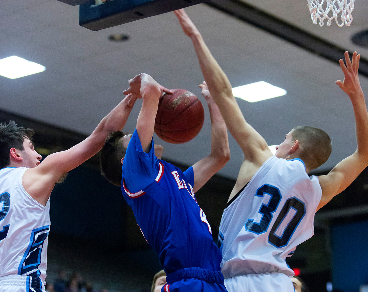 AUGUSTA, Maine -- 02/24/2017 -- Oceanside's Sam Atwood (left) blocks a shot from Messalonskee's James Kouletsis (center) while Oceanside's Amos Anderson provides defense during their Class A boys basketball championship game at the Augusta Civic Center in Augusta Friday. Ashley L. Conti | BDN