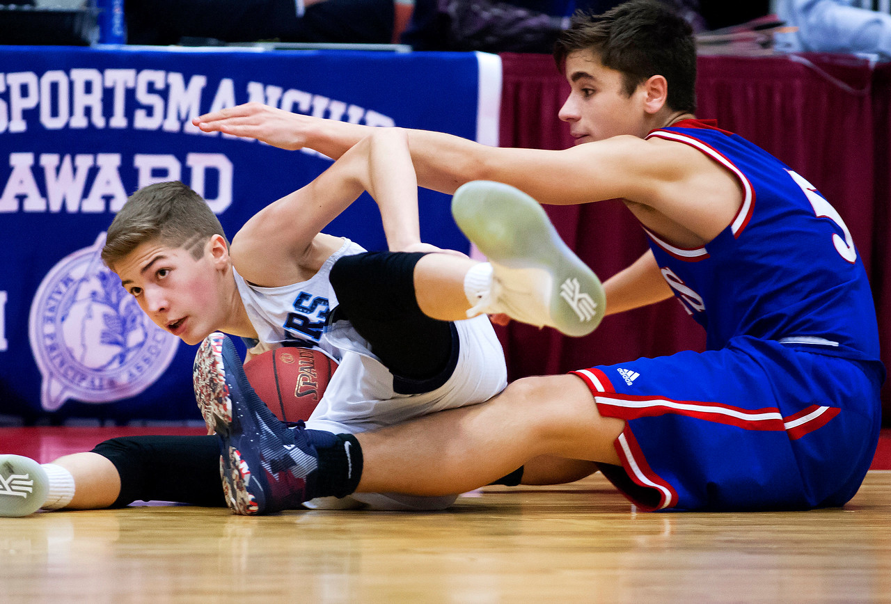 AUGUSTA, Maine -- 02/24/2017 -- Oceanside's Trevor Reed (left) and Messalonskee's Chase Warren battle for a loose ball during their Class A boys basketball championship game at the Augusta Civic Center in Augusta Friday. Ashley L. Conti | BDN