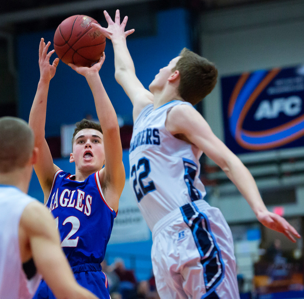 AUGUSTA, Maine -- 02/24/2017 -- Oceanside's Cooper Wirkala (right) blocks a shot from Messalonskee's Tucker Charles during their Class A boys basketball championship game at the Augusta Civic Center in Augusta Friday. Ashley L. Conti | BDN