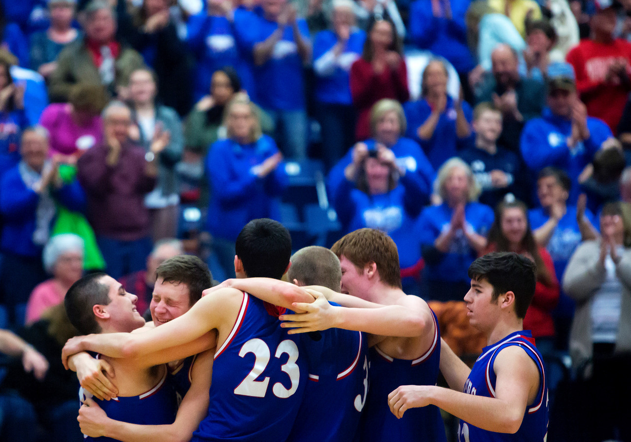 AUGUSTA, Maine -- 02/24/2017 -- Messalonskee celebrates after defeating Oceanside during their Class A boys basketball championship game at the Augusta Civic Center in Augusta Friday. Ashley L. Conti   BDN