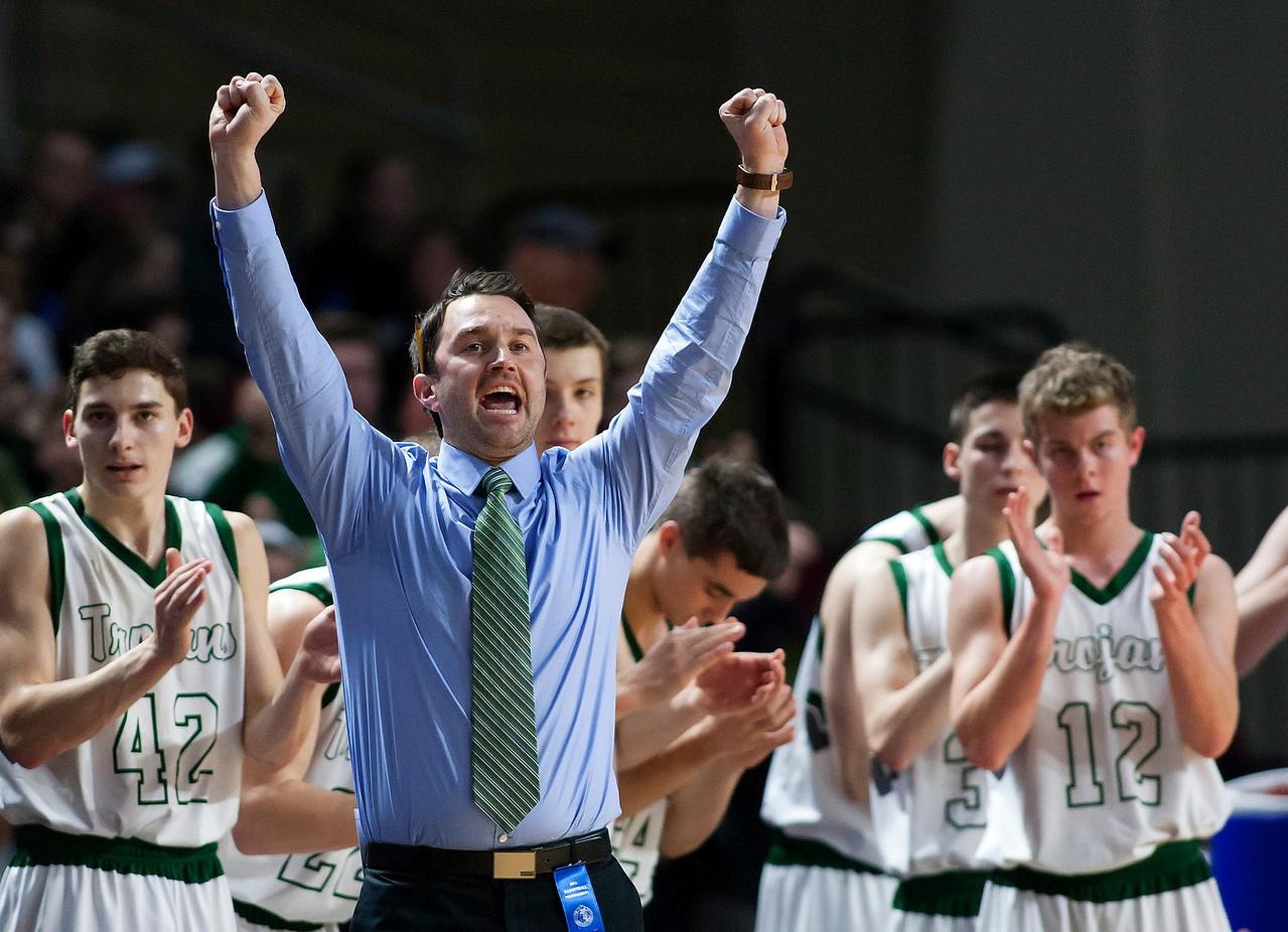 BANGOR, Maine -- 02/25/2017 -- Mount Desert Island head coach Justin Norwood cheers after his team scored against Orono during their Class B boys basketball championship game at the Cross Insurance Center in Bangor Saturday. Ashley L. Conti | BDN