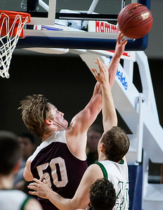 BANGOR, Maine -- 02/25/2017 -- Orono's Keenan Collett (left) blocks a shot from Mount Desert Island's Riley Swanson during their Class B boys basketball championship game at the Cross Insurance Center in Bangor Saturday. Ashley L. Conti | BDN