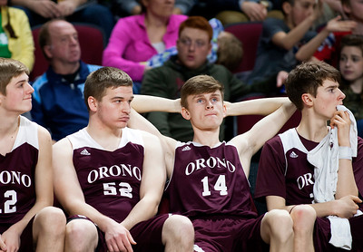 BANGOR, Maine -- 02/25/2017 -- Orono's Jonathan Spencer (second from right) looks to the scoreboard as time expires to give Mount Desert Island the win during their Class B boys basketball championship game at the Cross Insurance Center in Bangor Saturday. Ashley L. Conti | BDN