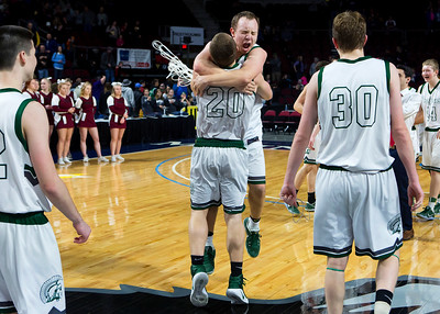 BANGOR, Maine -- 02/25/2017 -- Mount Desert Island's Graham Good (center) embraces Mount Desert Island's Riley Swanson after defeating Orono during their Class B boys basketball championship game at the Cross Insurance Center in Bangor Saturday. Ashley L. Conti | BDN