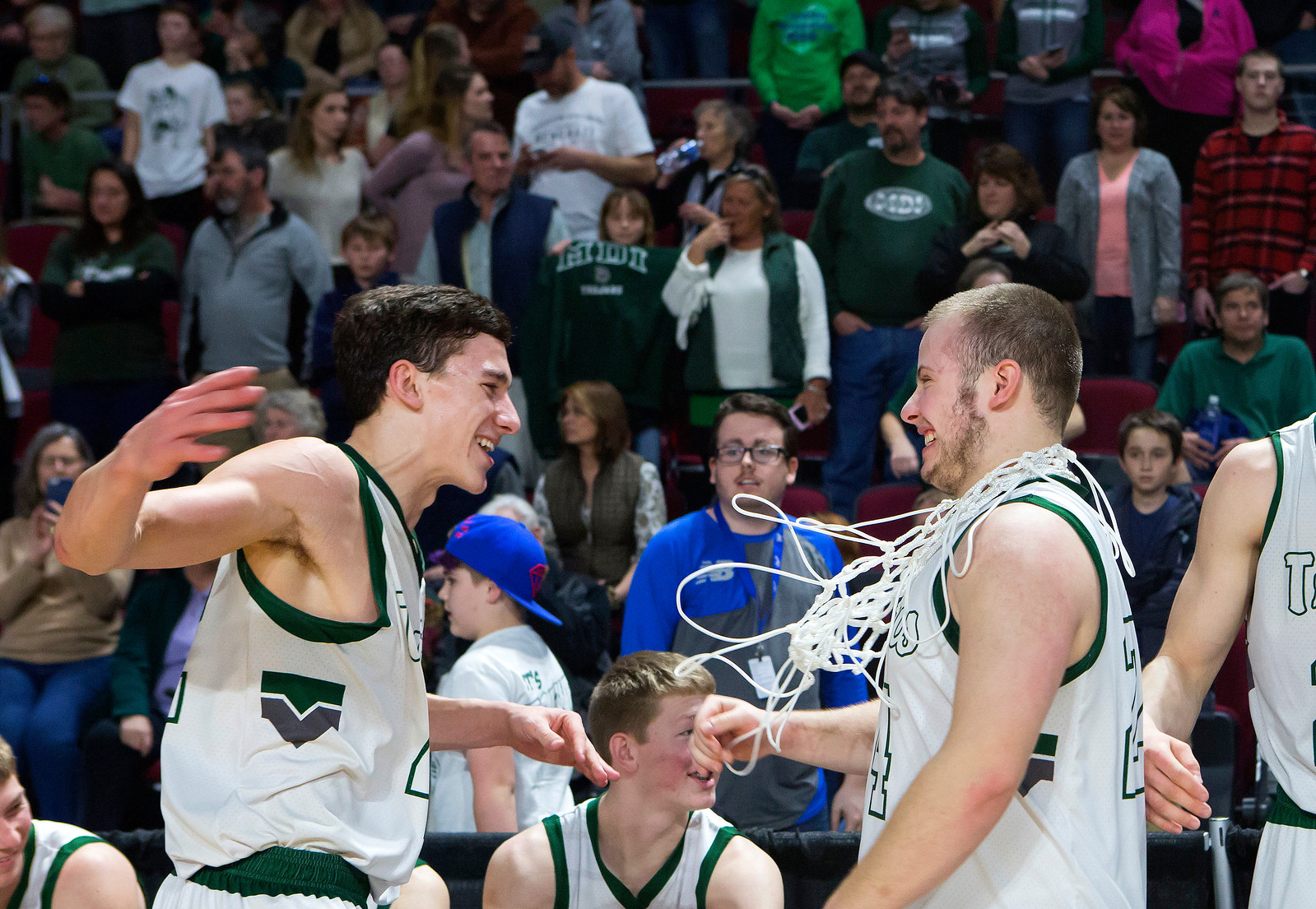BANGOR, Maine -- 02/25/2017 -- Mount Desert Island's Devin M. Parlatore (left) goes to embrace Mount Desert Island's Aaron Snurkowski after defeating Orono during their Class B boys basketball championship game at the Cross Insurance Center in Bangor Saturday. Ashley L. Conti | BDN