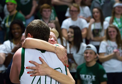 BANGOR, Maine -- 02/25/2017 -- Mount Desert Island's Riley Swanson embraces his mother after defeating Orono during their Class B boys basketball championship game at the Cross Insurance Center in Bangor Saturday. Ashley L. Conti | BDN