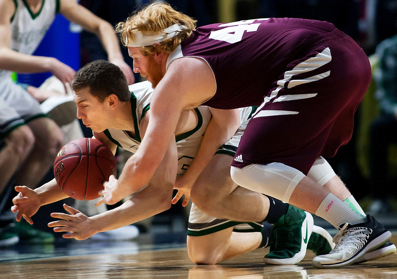 BANGOR, Maine -- 02/25/2017 -- Mount Desert Island's Graham Good (left) battles for a loose ball against Orono's Jackson Coutts during their Class B boys basketball championship game at the Cross Insurance Center in Bangor Saturday. Ashley L. Conti | BDN