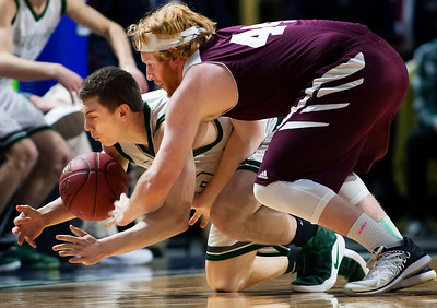 BANGOR, Maine -- 02/25/2017 -- Mount Desert Island's Graham Good (left) battles for a loose ball against Orono's Jackson Coutts during their Class B boys basketball championship game at the Cross Insurance Center in Bangor Saturday. Ashley L. Conti   BDN