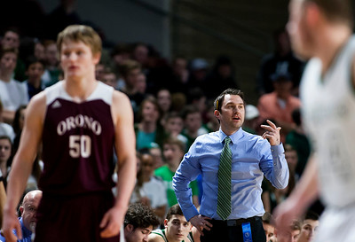 BANGOR, Maine -- 02/25/2017 -- Mount Desert Island head coach Justin Norwood gives the ball to his team during their Class B boys basketball championship game against Orono at the Cross Insurance Center in Bangor Saturday. Ashley L. Conti | BDN