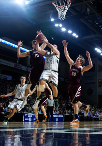 BANGOR, Maine -- 02/25/2017 -- Orono's Connor McCluskey (left) blocks a shot from Mount Desert Island's Aaron Snurkowski during their Class B boys basketball championship game at the Cross Insurance Center in Bangor Saturday. Ashley L. Conti | BDN