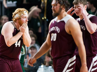 BANGOR, Maine -- 02/25/2017 -- Orono's Jackson Coutts (left) reacts after teammate Orono's Jake Koffman was called for a foul on Mount Desert Island during their Class B boys basketball championship game at the Cross Insurance Center in Bangor Saturday. Ashley L. Conti | BDN
