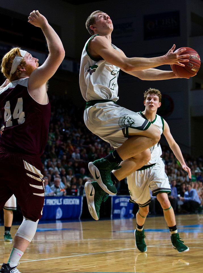 BANGOR, Maine -- 02/25/2017 -- Mount Desert Island's Graham Good (right) tries for two past Orono's Jackson Coutts during their Class B boys basketball championship game at the Cross Insurance Center in Bangor Saturday. Ashley L. Conti | BDN