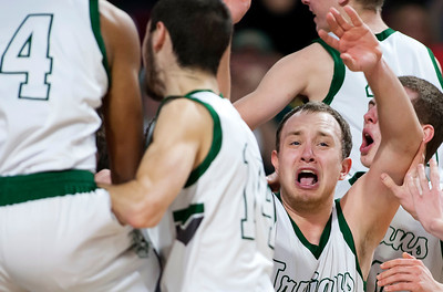 BANGOR, Maine -- 02/25/2017 -- Mount Desert Island celebrates after defeating Orono during their Class B boys basketball championship game at the Cross Insurance Center in Bangor Saturday. Ashley L. Conti | BDN