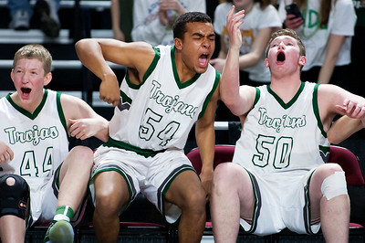 BANGOR, Maine -- 02/25/2017 -- Mount Desert Island's Andrew Shea (from left), Mount Desert Island's Owen Mild, and Mount Desert Island's MacLean Shea celebrate as their team defeats Orono during their Class B boys basketball championship game at the Cross Insurance Center in Bangor Saturday. Ashley L. Conti   BDN