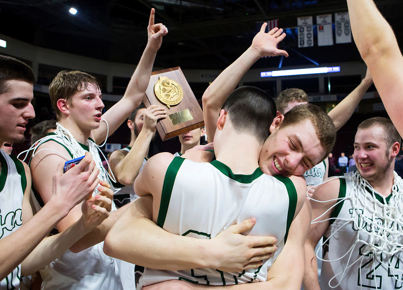 BANGOR, Maine -- 02/25/2017 -- Mount Desert Island's James Carroll (center) embraces Mount Desert Island's Graham Good after defeating Orono during their Class B boys basketball championship game at the Cross Insurance Center in Bangor Saturday. Ashley L. Conti | BDN