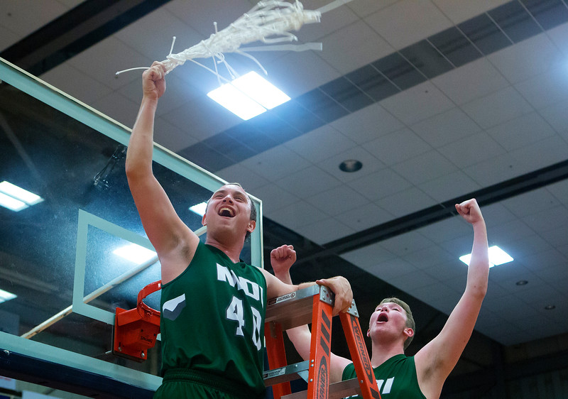 AUGUSTA, Maine -- 03/03/2017 -- Mount Desert Island's Riley Swanson (left) and Mount Desert Island's MacLean Shea celebrate after defeating Wells during their Class B boys basketball state championship at the Augusta Civic Center in Augusta Friday. Ashley L. Conti | BDN