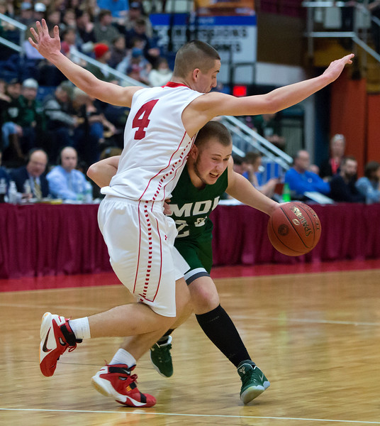 AUGUSTA, Maine -- 03/03/2017 -- Mount Desert Island's Aaron Snurkowski (right) drives the lane past Wells' Matt Sherburne during their Class B boys basketball state championship at the Augusta Civic Center in Augusta Friday. Ashley L. Conti | BDN