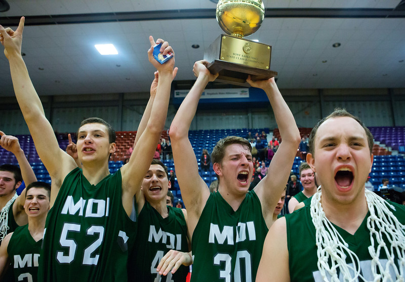 AUGUSTA, Maine -- 03/03/2017 -- Mount Desert Island celebrates after defeating Wells during their Class B boys basketball state championship at the Augusta Civic Center in Augusta Friday. Ashley L. Conti   BDN