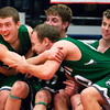 AUGUSTA, Maine -- 03/03/2017 -- Mount Desert Island celebrates as they realize they will take the win against Wells during their Class B boys basketball state championship at the Augusta Civic Center in Augusta Friday. Ashley L. Conti   BDN