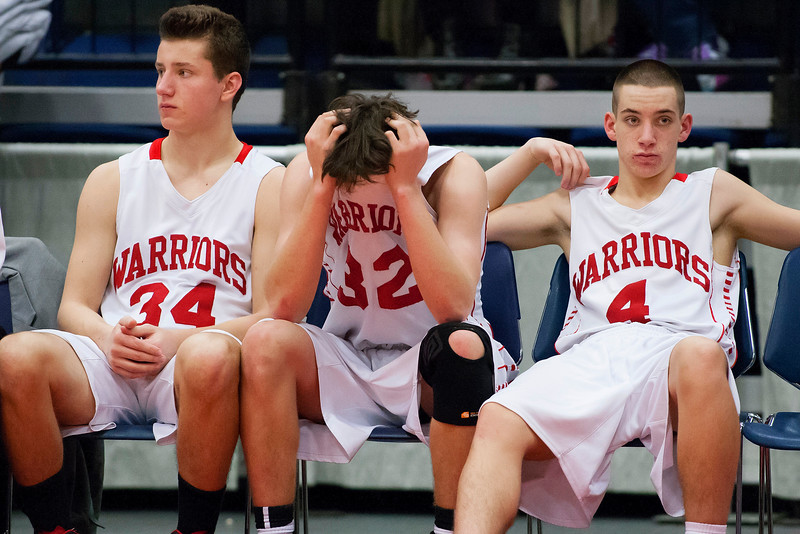 AUGUSTA, Maine -- 03/03/2017 -- Wells' Tyler Bridge (from left), Wells' Cameren Cousins, and Wells' Matt Sherburne sit dejected as time runs out during their Class B boys basketball state championship against Mount Desert Island at the Augusta Civic Center in Augusta Friday. Ashley L. Conti | BDN