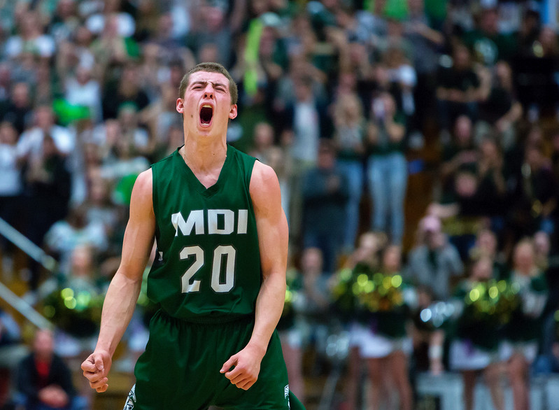 AUGUSTA, Maine -- 03/03/2017 -- Mount Desert Island's Graham Good celebrates after scoring against Wells during their Class B boys basketball state championship at the Augusta Civic Center in Augusta Friday. Ashley L. Conti | BDN