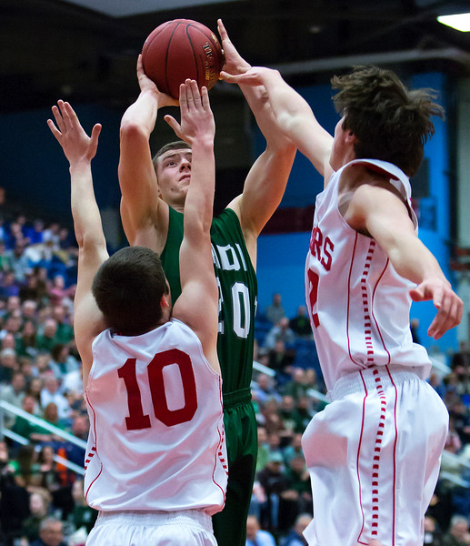 AUGUSTA, Maine -- 03/03/2017 -- Mount Desert Island's Graham Good (center) goes up for two past Wells' Riley Dempsey (left) and Wells' Cameren Cousins during their Class B boys basketball state championship at the Augusta Civic Center in Augusta Friday. Ashley L. Conti | BDN