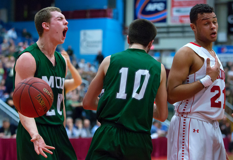 AUGUSTA, Maine -- 03/03/2017 -- Mount Desert Island's Graham Good (left) celebrates after his teammate Mount Desert Island's Andrew Phelps' basket suck after being fouled during their Class B boys basketball state championship at the Augusta Civic Center in Augusta Friday. Ashley L. Conti | BDN