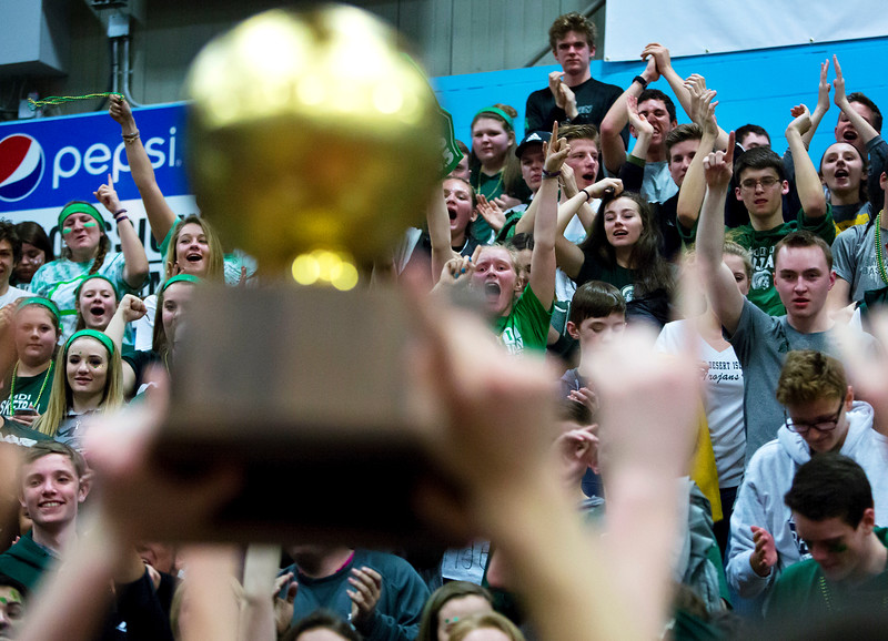 AUGUSTA, Maine -- 03/03/2017 -- Mount Desert Island student section cheers as their team holds up the golden ball after defeating Wells during their Class B boys basketball state championship at the Augusta Civic Center in Augusta Friday. Ashley L. Conti | BDN
