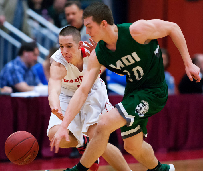AUGUSTA, Maine -- 03/03/2017 -- Wells' Matt Sherburne (left) and Mount Desert Island's Graham Good battle for a loose ball during their Class B boys basketball state championship at the Augusta Civic Center in Augusta Friday. Ashley L. Conti | BDN
