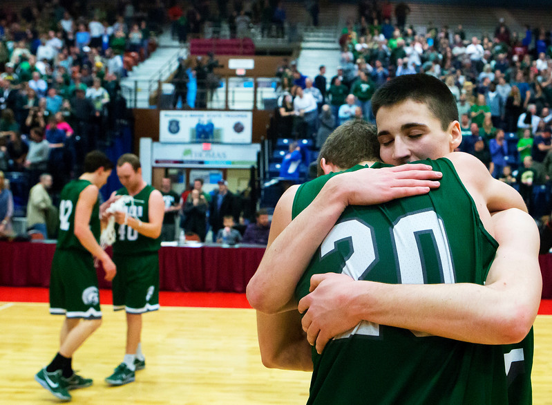 AUGUSTA, Maine -- 03/03/2017 -- Mount Desert Island's Graham Good (left) embraces Mount Desert Island's James Carroll after defeating Wells during their Class B boys basketball state championship at the Augusta Civic Center in Augusta Friday. Ashley L. Conti | BDN