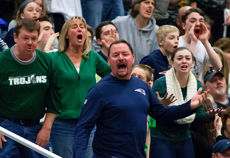 AUGUSTA, Maine -- 03/03/2017 -- Mount Desert Island fans yell after a call against them during their Class B boys basketball state championship against Wells at the Augusta Civic Center in Augusta Friday. Ashley L. Conti   BDN