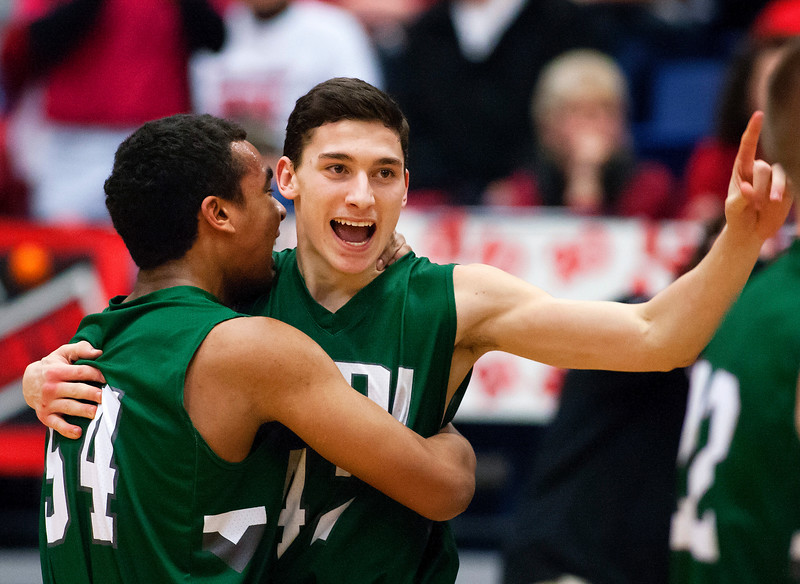 AUGUSTA, Maine -- 03/03/2017 -- Mount Desert Island's Owen Mild (left) celebrates with Mount Desert Island's Devin M. Parlatore after defeating Wells during their Class B boys basketball state championship at the Augusta Civic Center in Augusta Friday. Ashley L. Conti   BDN
