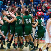 AUGUSTA, Maine -- 03/03/2017 -- Mount Desert Island celebrates after defeating Wells during their Class B boys basketball state championship at the Augusta Civic Center in Augusta Friday. Ashley L. Conti | BDN