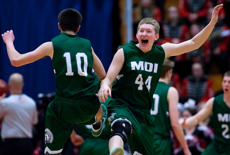 AUGUSTA, Maine -- 03/03/2017 -- Mount Desert Island's Andrew Phelps (left) celebrates with teammate Mount Desert Island's Andrew Shea after the first half of their Class B boys basketball state championship against Wells at the Augusta Civic Center in Augusta Friday. Ashley L. Conti | BDN