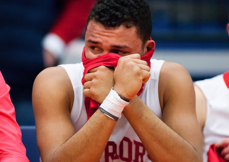 AUGUSTA, Maine -- 03/03/2017 -- Wells' Deandre Woods sits with tears in his eyes after being defeated by Mount Desert Island during their Class B boys basketball state championship at the Augusta Civic Center in Augusta Friday. Ashley L. Conti | BDN