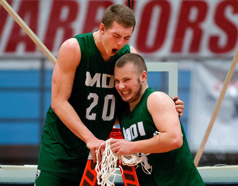 AUGUSTA, Maine -- 03/03/2017 -- Mount Desert Island's Graham Good (left) and Mount Desert Island's Aaron Snurkowski celebrate after defeating Wells during their Class B boys basketball state championship at the Augusta Civic Center in Augusta Friday. Ashley L. Conti | BDN