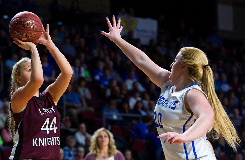 BANGOR, Maine -- 02/21/2017 -- Narraguagus' Kaci Alley (left) puts up a shot past Stearns' Julia Stanley during their Class C girls basketball quarterfinal game at the Cross Insurance Center in Bangor Tuesday. Ashley L. Conti | BDN