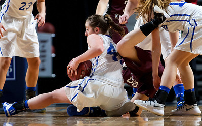BANGOR, Maine -- 02/21/2017 -- Stearns' Peighton Ingersoll (left) wins a loose ball against Narraguagus' Kirstin Kennedy during their Class C girls basketball quarterfinal game at the Cross Insurance Center in Bangor Tuesday. Ashley L. Conti | BDN