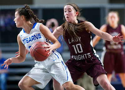 BANGOR, Maine -- 02/21/2017 -- Stearns' Emma Alley (left) drives around Narraguagus' Madison Leighton during their Class C girls basketball quarterfinal game at the Cross Insurance Center in Bangor Tuesday. Ashley L. Conti | BDN